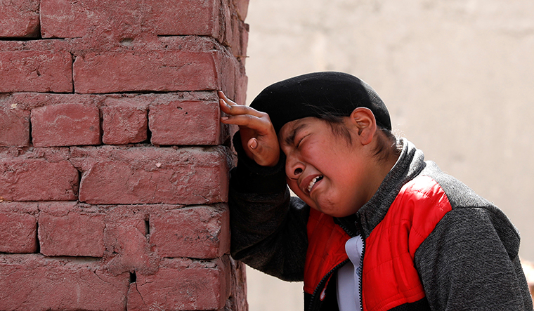 Grief unbound: An Afghan Sikh boy mourns the victims of the Kabul gurdwara attack | REUTERS