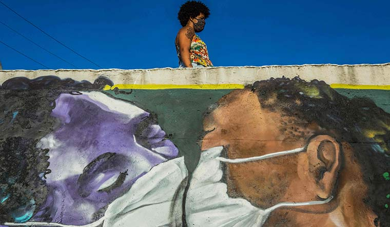 Unmasking the reality: African descendants in Brazil are hit hard by the pandemic, which has thrown light on racial inequalities in the country | AFP