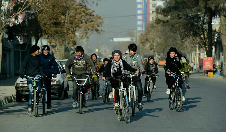Rare good times: Youngsters cycling in Kabul in January 2018 | Sanjoy Ghosh