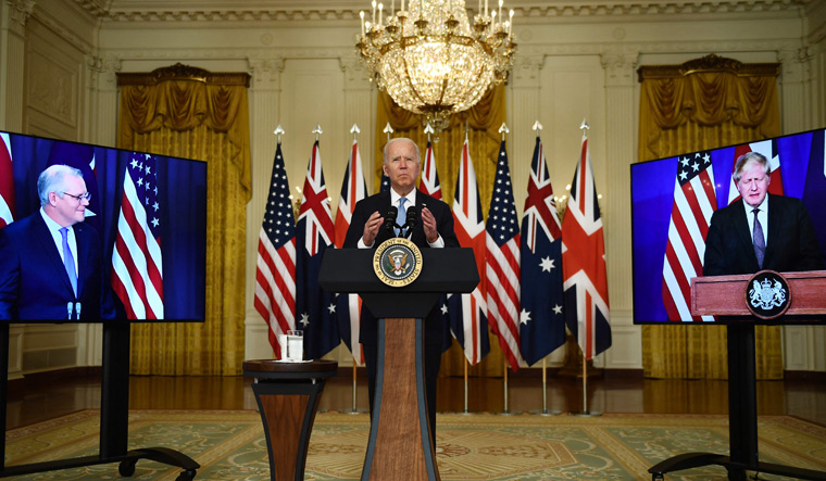 United we stand: US President Joe Biden in a virtual press conference with British Prime Minister Boris Johnson (right) and Australian Prime Minister Scott Morrison, announcing the formation of AUKUS   AFP