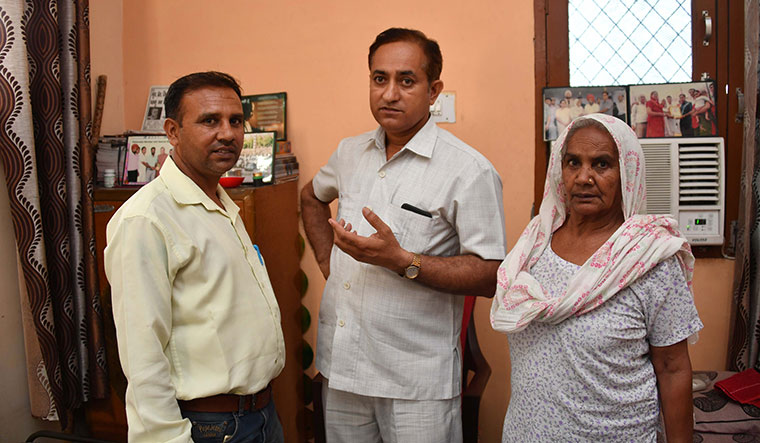 Cured through counselling: Shakuntala and her son, Pradeep Kumar, with rationalist Krishan Lal (centre) | Arvind Jain