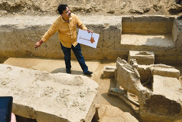 Chariot of yore: S.K. Manjul, director, Institute of Archaeology, with the copper chariot at the Sanauli excavation site | Sanjay Ahlawat