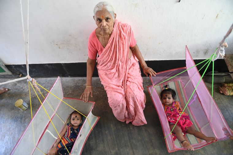 Inspiring mother: young women from mangayamma's village, who aspire to have children through ivf, approach her for blessings now.