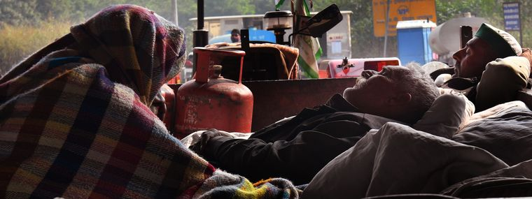 For a better tomorrow: Farmers sleeping on a tractor at the Delhi-Ghazipur border | J. Suresh