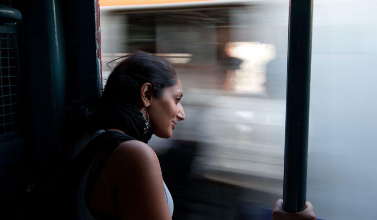 Into the distance: Monisha Rajesh in a Mumbai local