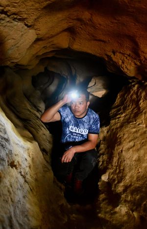 Longer, deeper, darker: Bah Shim, our guide, inside Krem Puri, the longest sandstone cave in the world | Salil Bera