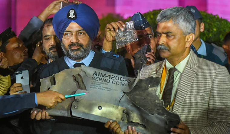 Thwarted counterattack: Indian Air Force officers show parts of an exploded AMRAAM missile fired by Pakistani fighter jets, in Delhi on February 28 | PTI