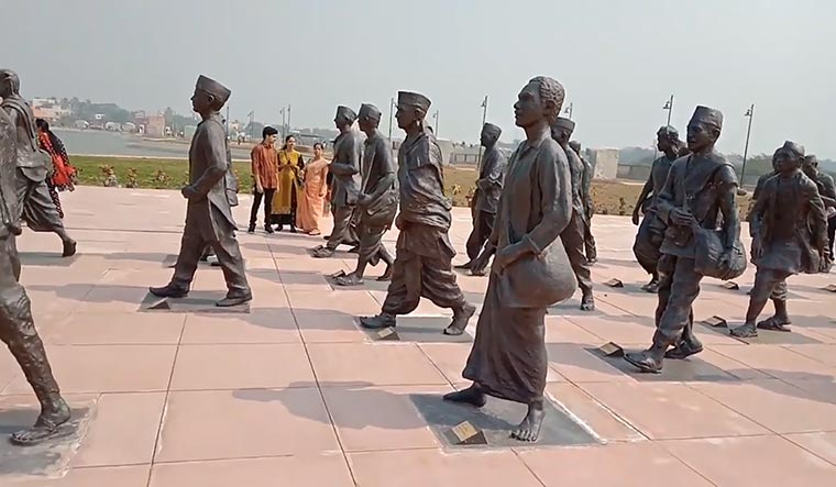 A moment to savour: statue of titus in the foreground with those of other dandi marchers at the national salt satyagraha memorial created by IIT Mumbai at Dandi.