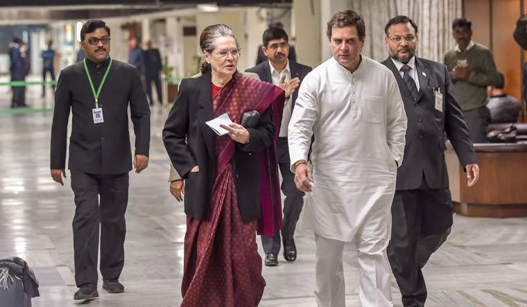 Balancing powers: Congress interim president Sonia Gandhi with Rahul Gandhi at a meeting of opposition leaders in Delhi | PTI
