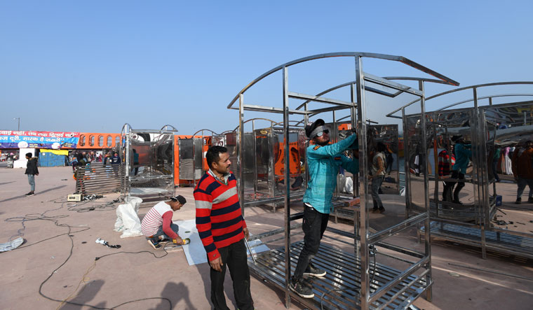 A cabin being installed for devotees to change clothes after a sacred dip at the Har ki Pauri on the banks of the Ganga