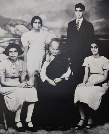 An old photo of Joe with his grandmother and sisters.