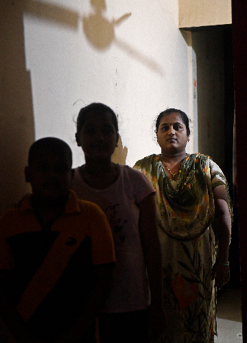 Uncertain future: Neeta Kshirsagar, who lost her husband to Covid -19 last year, with her daughter and son in thier house in Thane, Maharashtra | Amey Mansabdar