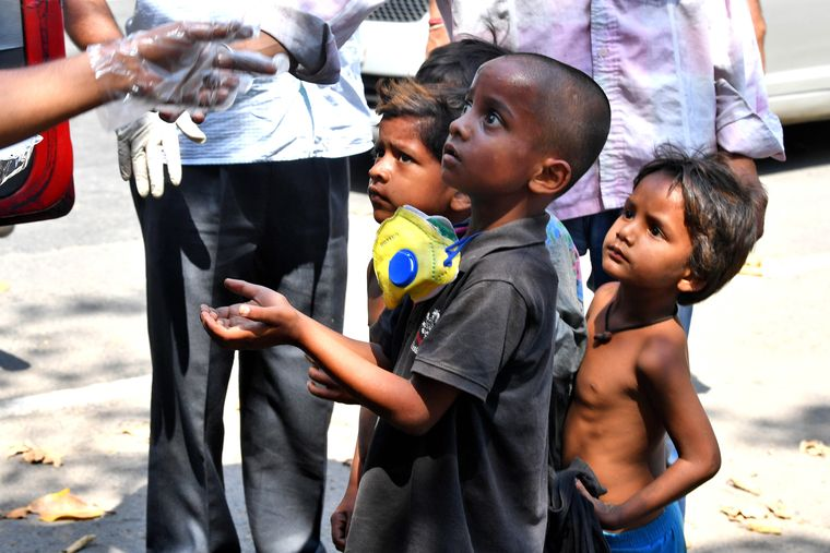 Stolen childhood: Children who live on streets in Kolkata waiting for food from a social worker | Salil Bera