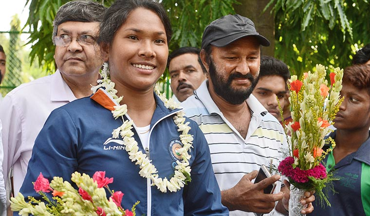 Guiding light: Swapna with coach Subhash Sarkar (right).