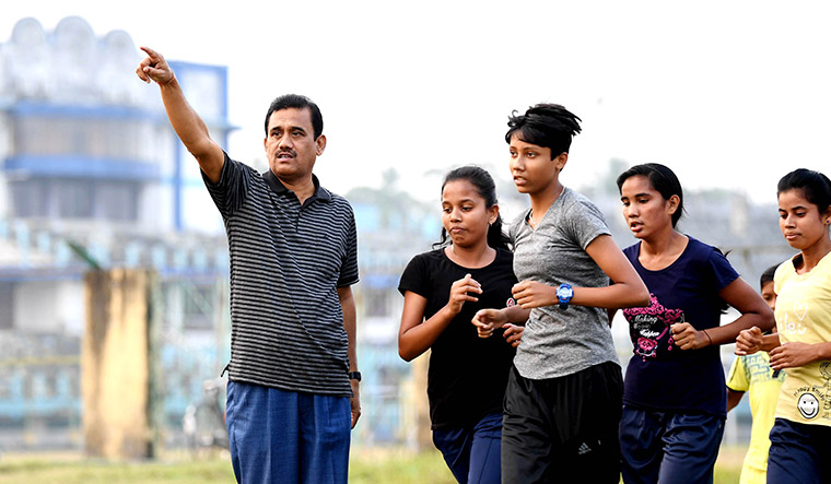 Scout, leader: Swapna's first coach Sukanta Sinha with his wards.