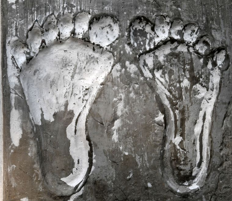 Feet and feat: An impression of Swapna's feet on cement, kept at her Jalpaiguri home.