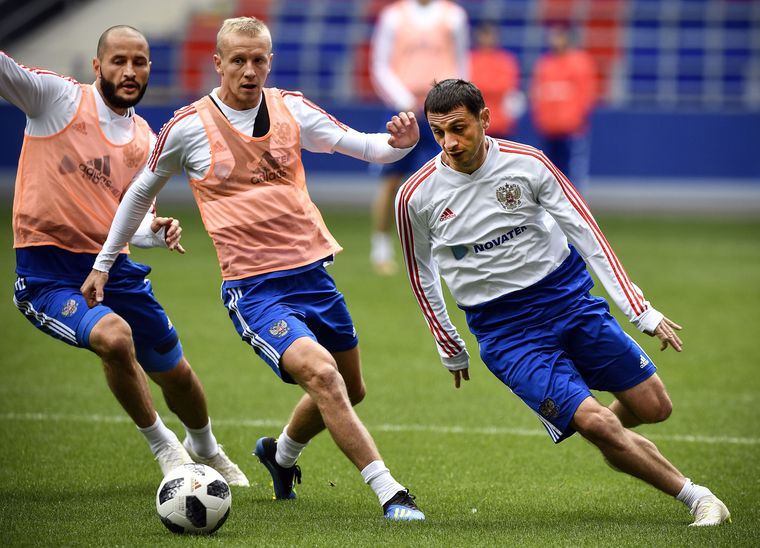 Eyeing glory: Russian players (from right) playmaker Alan Dzagoev, and defenders Igor Smolnikov and Fyodor Kudryashov in traning | AFP