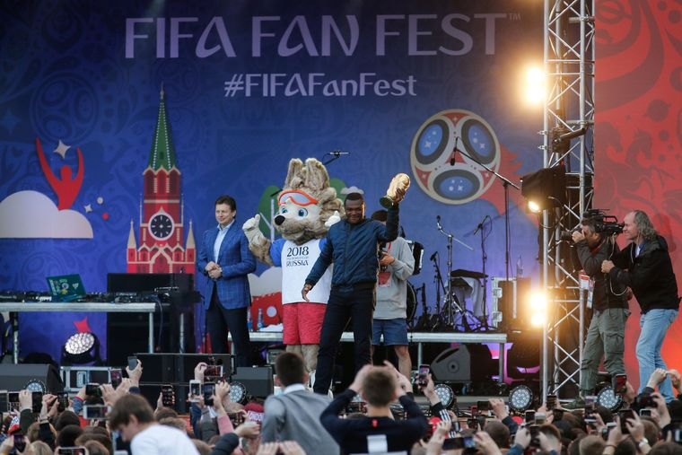 For the prople: Former French defender Marcel Desailly presents the FIFA World Cup trophy during the opening ceremony of the FIFA Fan Fest in Moscow. Fan Fests are places which screen matches and provides entertainmet programmes to fans free of charge on matchdays | AFP