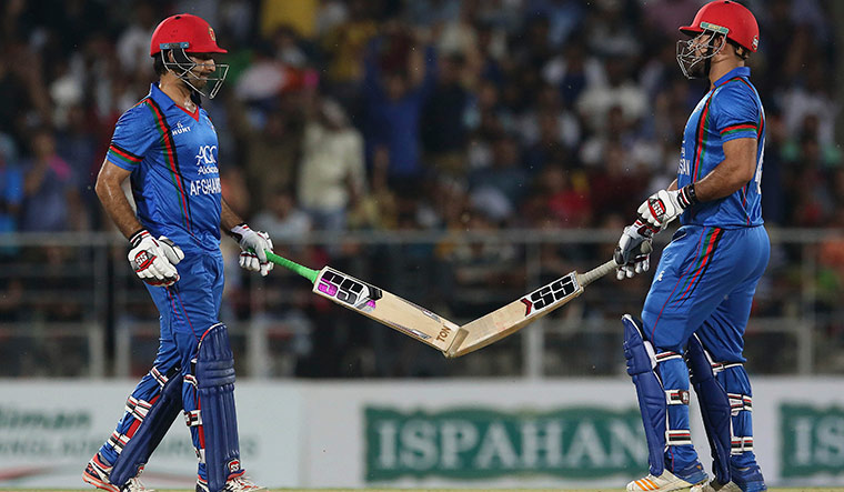 Asghar Stanikzai (left) and Samiullah Shenwari celebrate a six during the third T20 match against Bangladesh on June 8 | AP