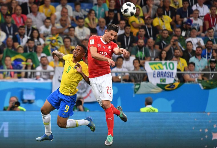 Tough contest: Switzerland's Fabian Schaer competing with Brazil's Gabriel Jesus for the ball | AFP