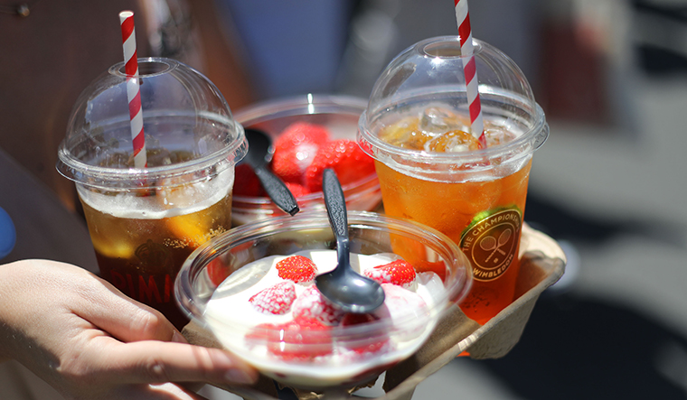 Summer delight: Strawberries and cream with glasses of Pimm's | Getty Images