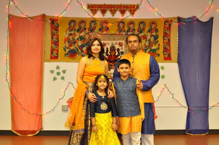 The Mishras at a local cultural event in New Jersey.