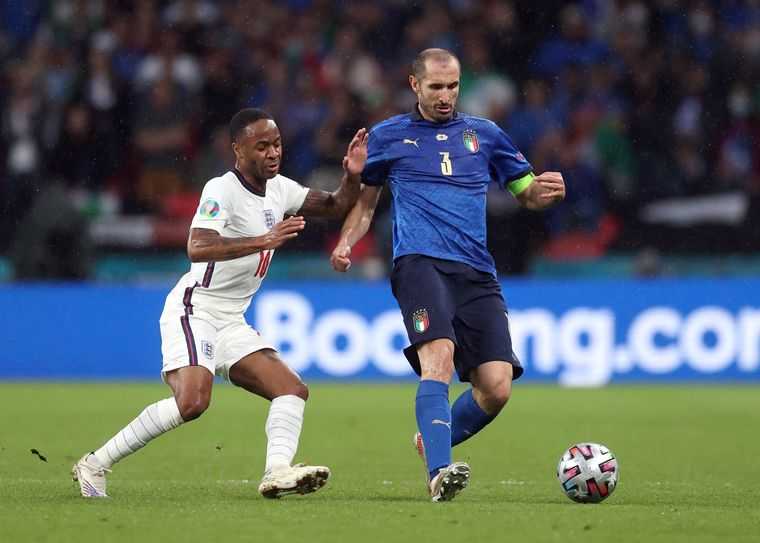 Pass and move: Chiellini (right) wrests the ball from England's Raheem Sterling in the final | AFP