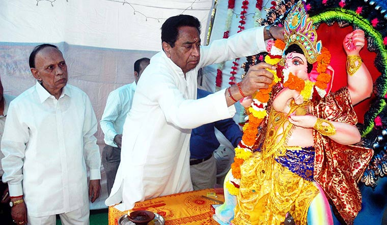 Reaching out: Kamal Nath garlands the Ganapati idol at the party office in Bhopal.