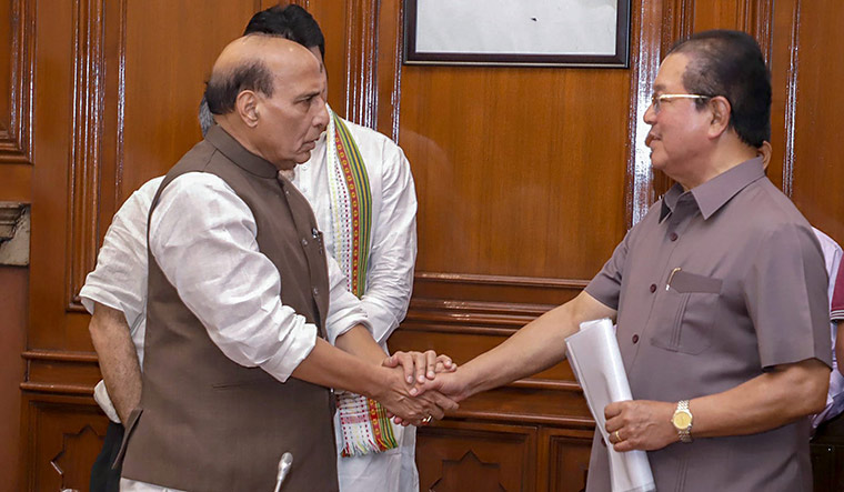 Pact impact: Home Minister Rajnath Singh  with Mizoram Chief Minister Lal Thanhawla after signing an agreement on Bru repatriation | PTI