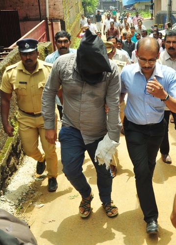 Uncovering the truth: Subahani being brought to  his home in Thodupuzha for evidence collection.