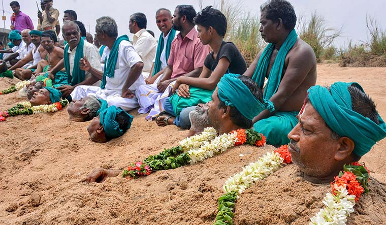 Neck-deep in misery: Farmers in the Cauvery riverbed at Tiruchirapalli protest the delay in setting up the Cauvery Management Board | PTI