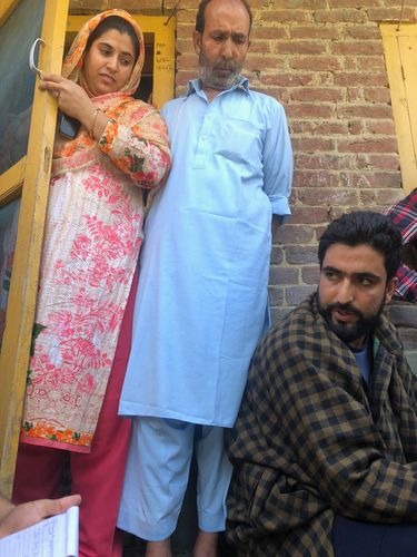 Agony in the eyes: constable muhammad tufail (sitting), whose brother zubair ahmad was kidnapped by militants. His sister and uncle standing nearby | Umer Asif