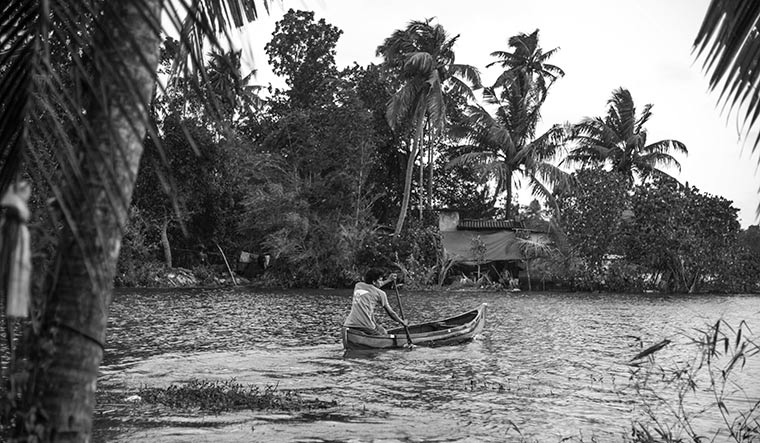 Drifting along: Boats remain the only mode of transporation for Akhil and his family, as their home is cut off by floodwaters.