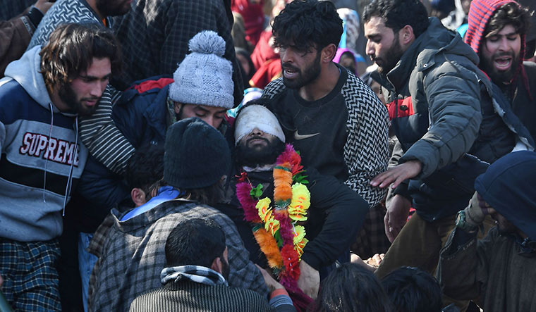 State of conflict: People carrying the body of slain militant Zeenat-ul-Islam in Shopian on January 13 | AFP