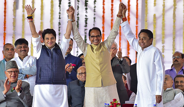Unity in diversity: Chouhan with Kamal Nath and senior Congress leader Jyotiraditya Scindia at Nath's swearing-in ceremony | Reuters