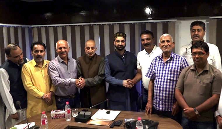 Return ticket: Mirwaiz Umar Farooq meets the Kashmiri Pandit delegation.