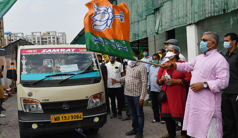 Helping hand: BJP leader Dilip Ghosh flagging off the distribution of relief material   Salil Bera