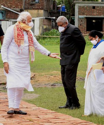 Taking stock: Prime Minister Modi with Governor Jagdeep Dhankhar and Mamata Banerjee during the review of the cyclone situation | PTI