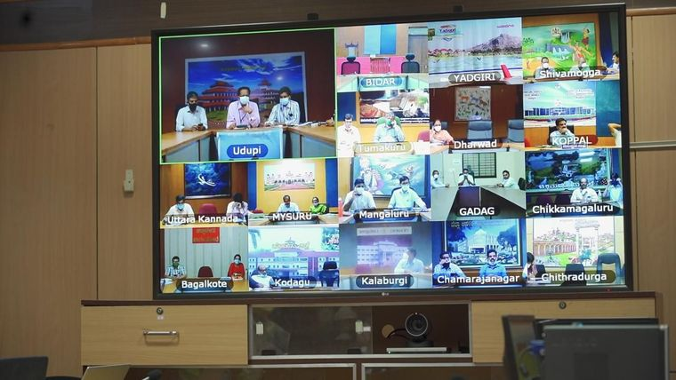 A screen showing representatives of various districts with Tele ICU setup during a review meeting