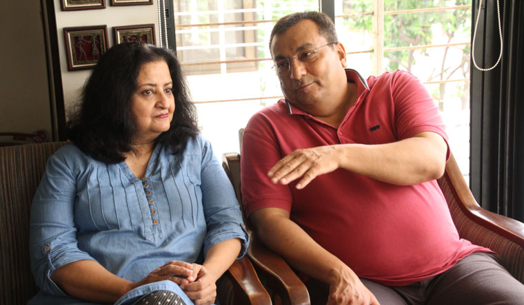 Chetan Raval, who got treated at home, with wife, Diana | Janak Patel