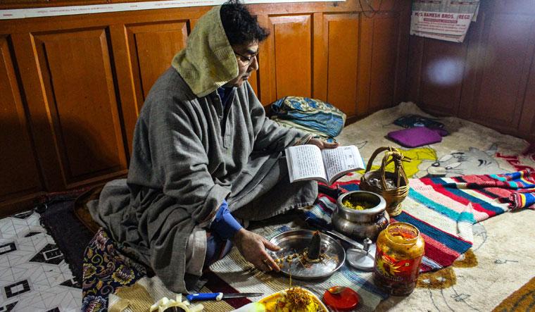 For a better Future: Rattan Chaku, general secretary of Kashmiri Pandits Sangharsh Samiti, performs puja at his home in Srinagar