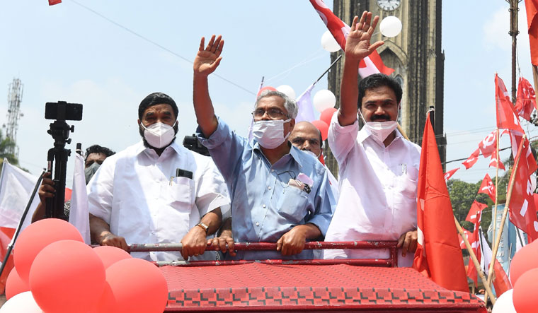 Prime position: Jose K. Mani of the Kerala Congress (M) (right), a new constituent of the LDF, at a rally organised by the front   Vignesh Krishnamoorthy