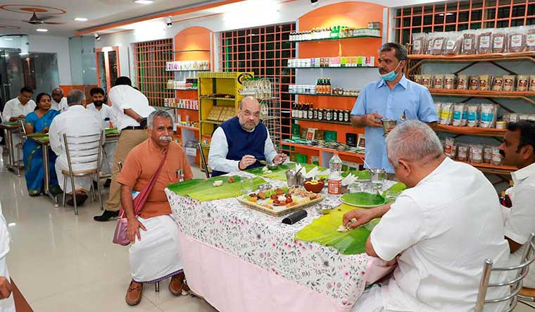 Food for thought: Union Home Minister Amit Shah and BJP leaders eating at a hotel at Madurantakam in Chengalpattu, Tamil Nadu | PTI