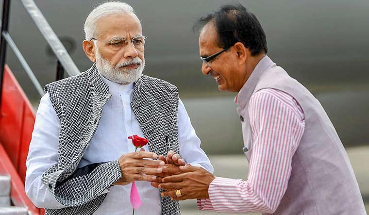 Uneasy calm: Prime Minister Narendra Modi with Shivraj Singh Chouhan | PTI