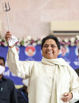 Raring to return: BSP chief Mayawati during a meeting with supporters at the party office in Lucknow | Getty Images
