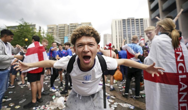 An England fan reacts as crowds gather outside the ground, ahead of the Euro 2020 soccer championship final match between England and Italy, at Wembley Stadiumv  AP