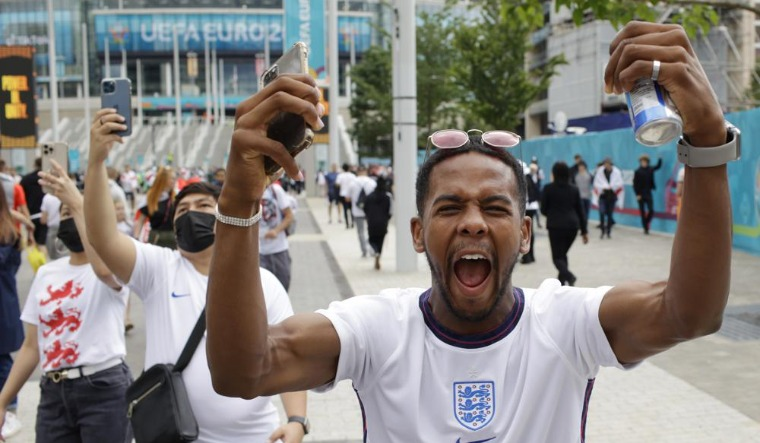 Euro-cup-final-England-fan-cheers-outside-Wembley-Stadium-ap