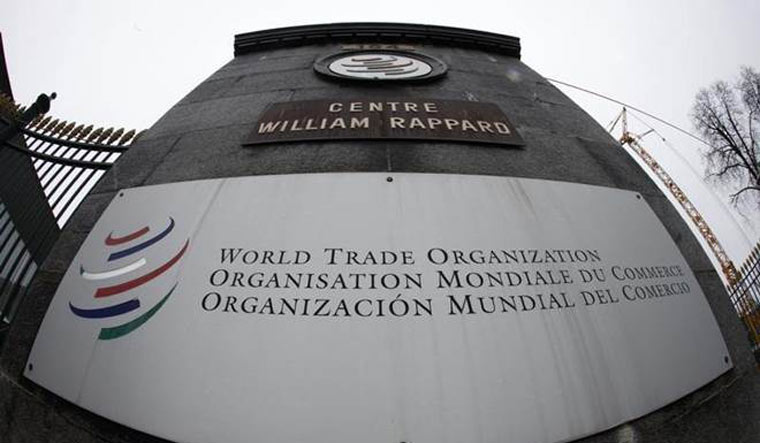 The World Trade Organization logo at the entrance of its headquarters in Geneva | Reuters