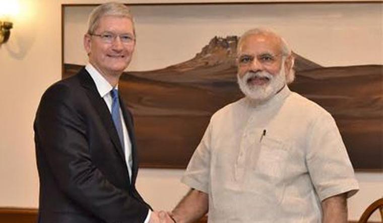 Apple CEO Tim Cook with PM Narendra Modi | File
