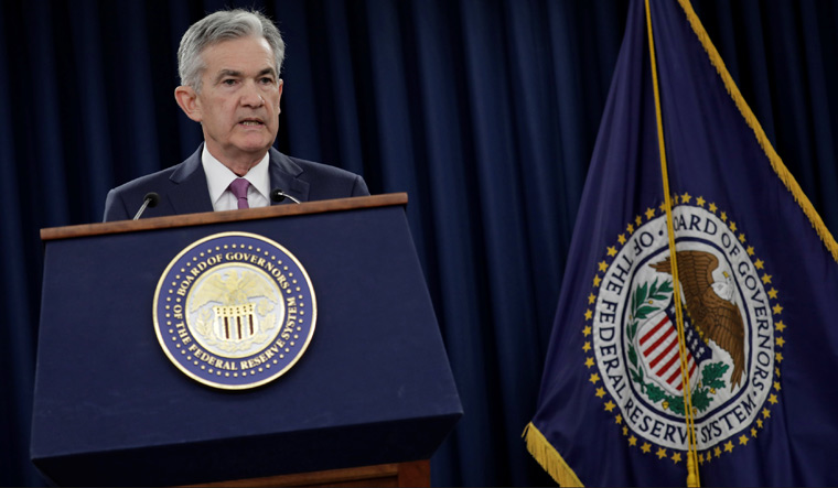 Federal Reserve bumps up USA  interest rate, signals two more in 2018